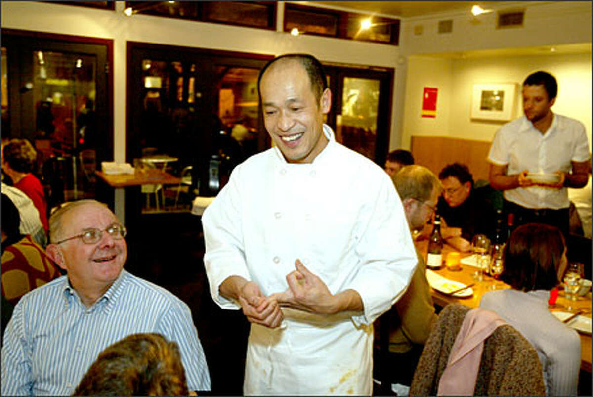 Chef Eric Banh's passion for food is evident in a conversation with customers at Monsoon, the Capitol Hill restaurant he owns with his sister.