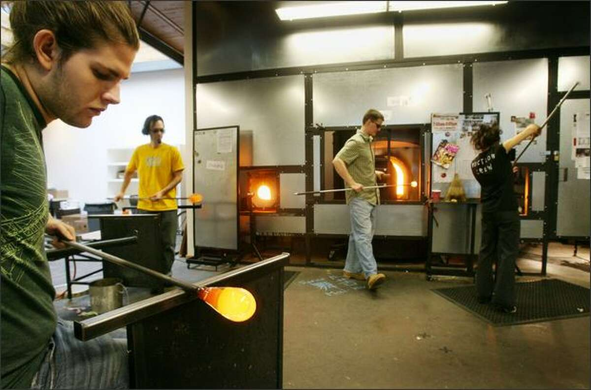 Glass blowers (from left) Jesse Nelson, Ryan Mellinger, Mike Eader and Brittaney Shanta make handblown tumblers at glassybaby's Madrona studio.