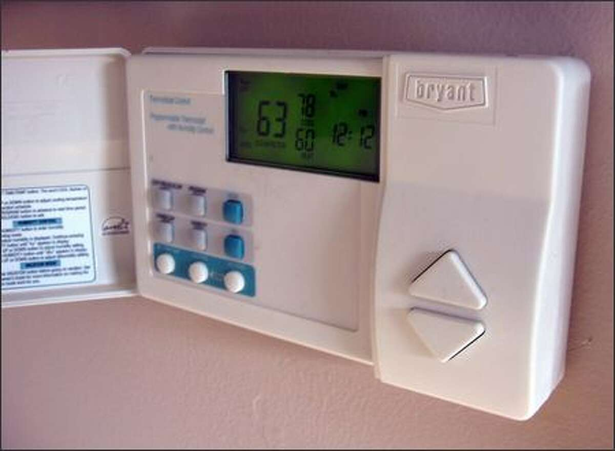 This electronic thermostat holds the room temperature within one degree of its setting. (JAMES DULLEY)