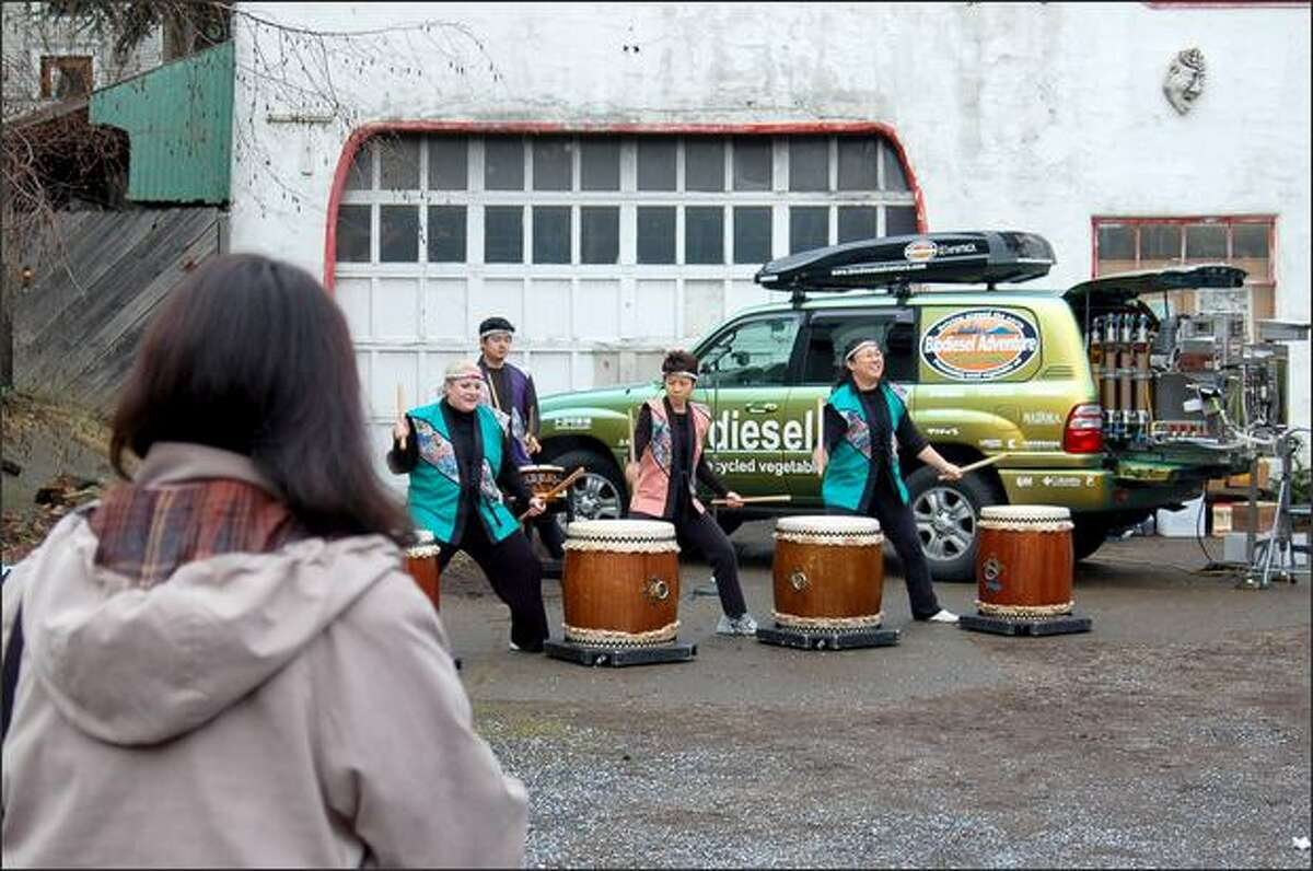 """The Japanese drumming ensemble Seattle Kokon Taiko loudly celebrates the arrival of Biodiesel Adventure's traveling """"waste vegetable oil"""" refinery at the Dirty Hands Biodiesel Cooperative in Madrona."""
