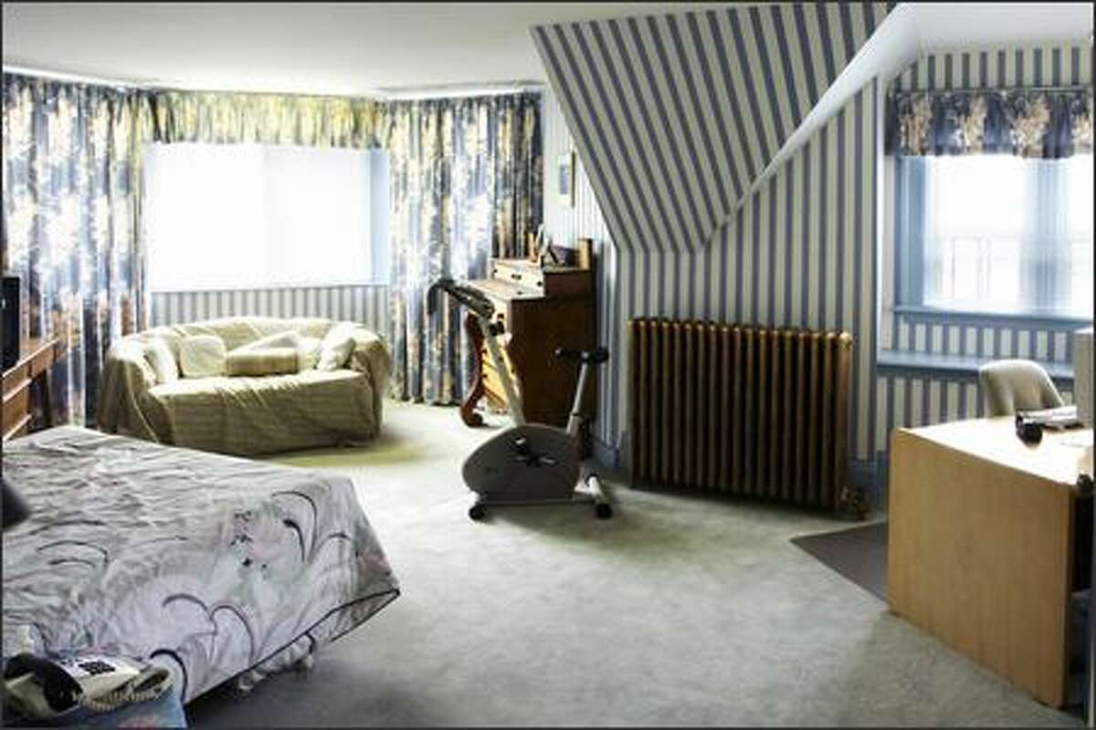 Before: Hypnotic striped wallpaper made the room's angles more awkward.