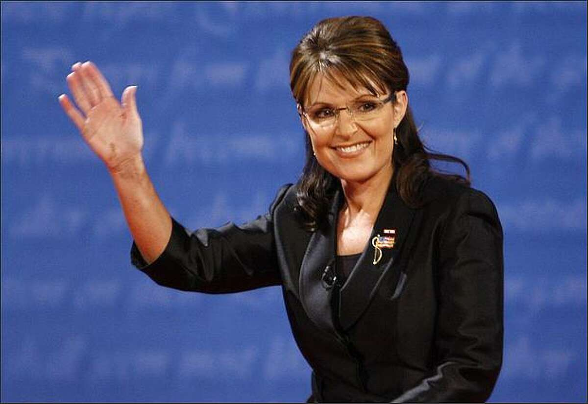 Alaska Gov. Sarah Palin waves as she steps on stage before the vice presidential debate at Washington University in St. Louis, Mo., on Oct. 2, 2008.