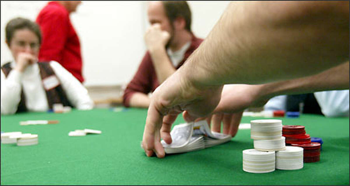 Students play Texas Hold'em in a UW poker class. In addition to the classroom, fans can find their game online and on TV.