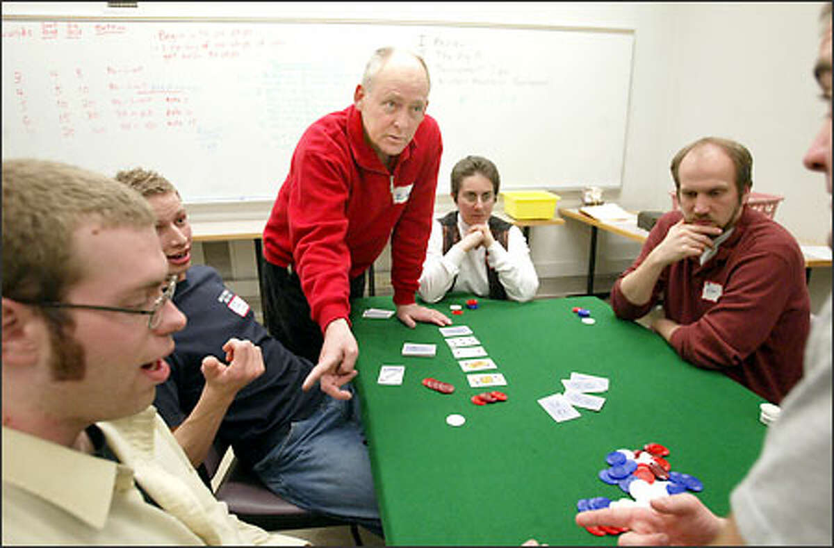 Larry Zeldner gives his students pointers on getting the pot straight during a tournament on the final night of poker class at the UW.