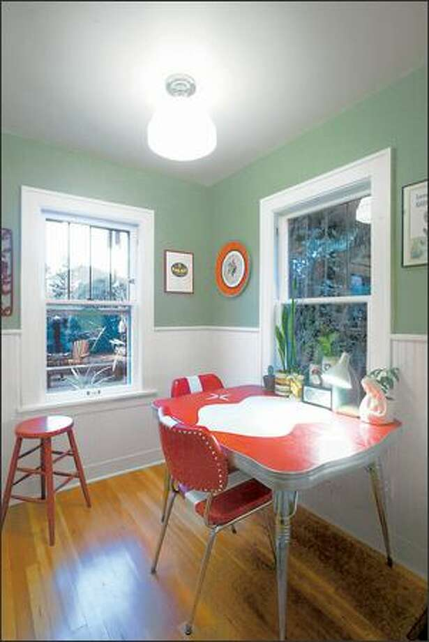 Adding wainscoting helps bring warmth to the eating nook, which features the much beloved red dinette set. Photo: Mike Urban, Seattle Post-Intelligencer / Seattle Post-Intelligencer