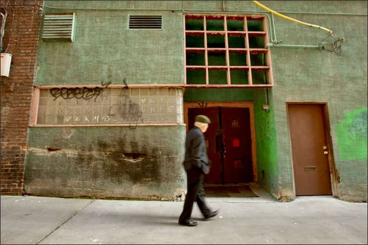 The padlocked doors of the Wah Mee club, in an alley off South King Street in the International District, still attract tourists by the busload. A neighboring businessman says some people still refuse to work in the area because of memories of the mass murder that occurred there on Feb. 19, 1983.