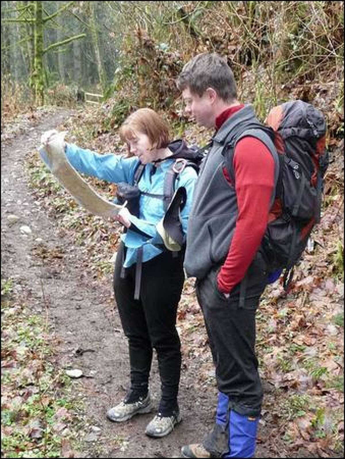 Snohomish residents Kelly and Matt Cleman ponder the map on the confusing Equestrian Loop on Squak Mountain, which seems to be a work in progress.