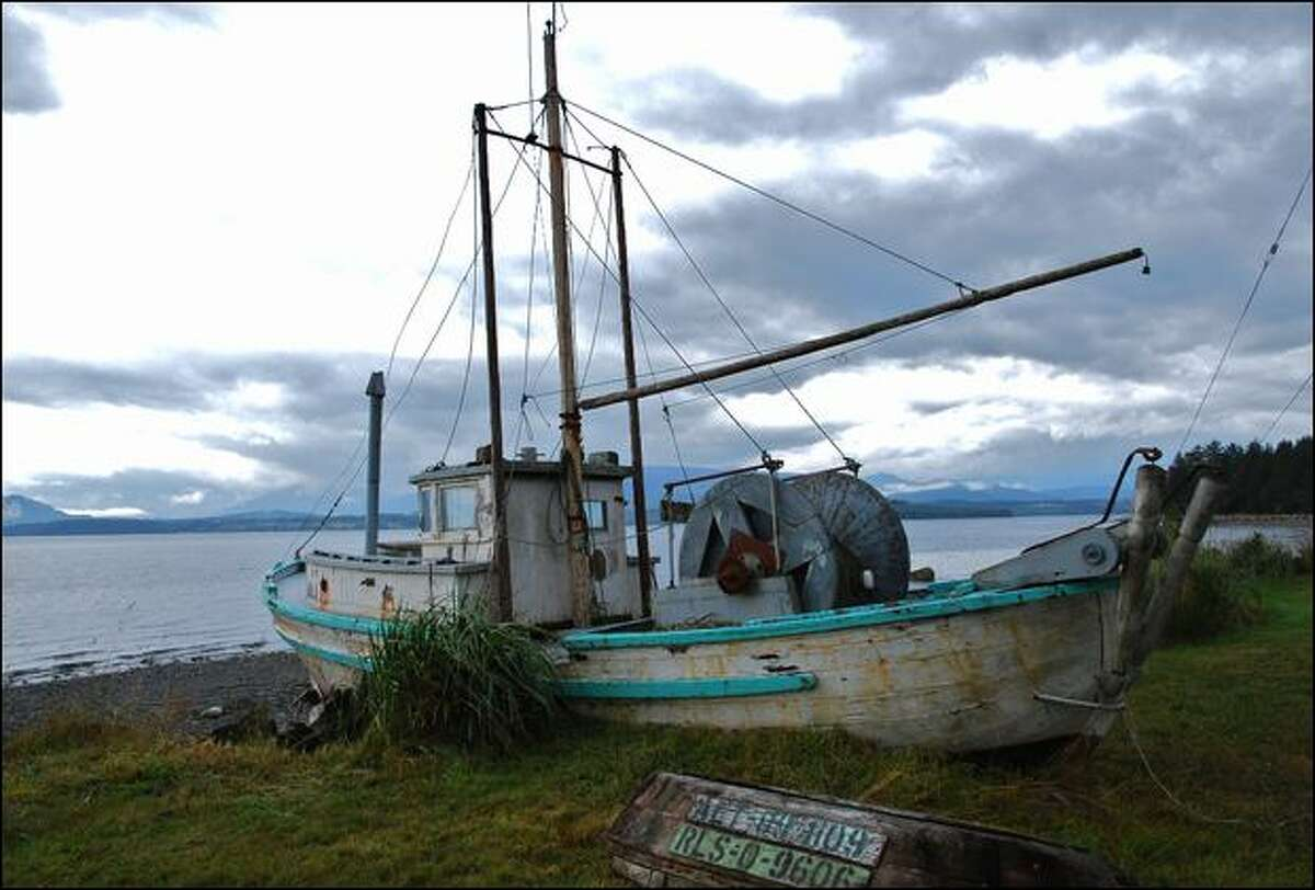 FILE -- An old boat rests in the grass at Sointula, a quaint fishing village on Malcolm Island off the northeast tip of Vancouver Island. (Alison Appelbe)