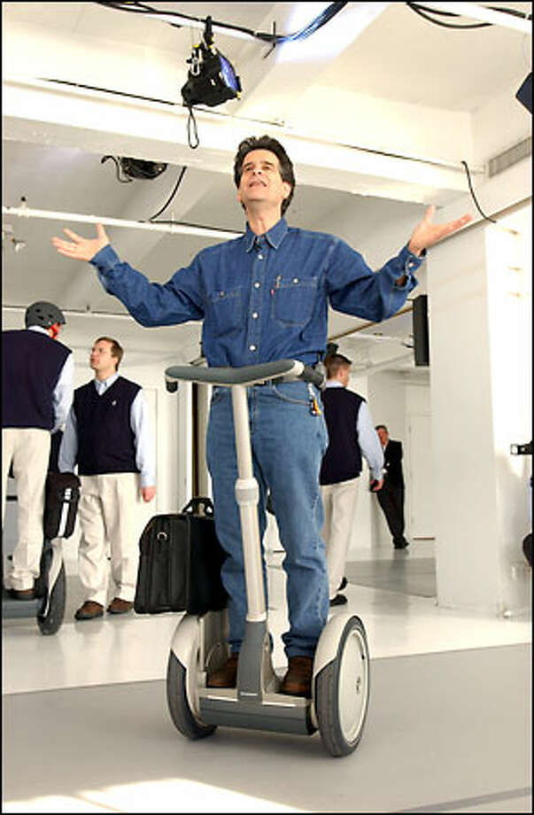 "Segway enthusiasts proved yesterday that money is no object when it comes to ""IT."" Bidding reached $50,000 in the first day of an Amazon.com auction for three of the hotly anticipated scooters, demonstrated here by inventor Dean Kamen. Bids will be accepted until March 28. Photo: Bloomberg News / Bloomberg News"