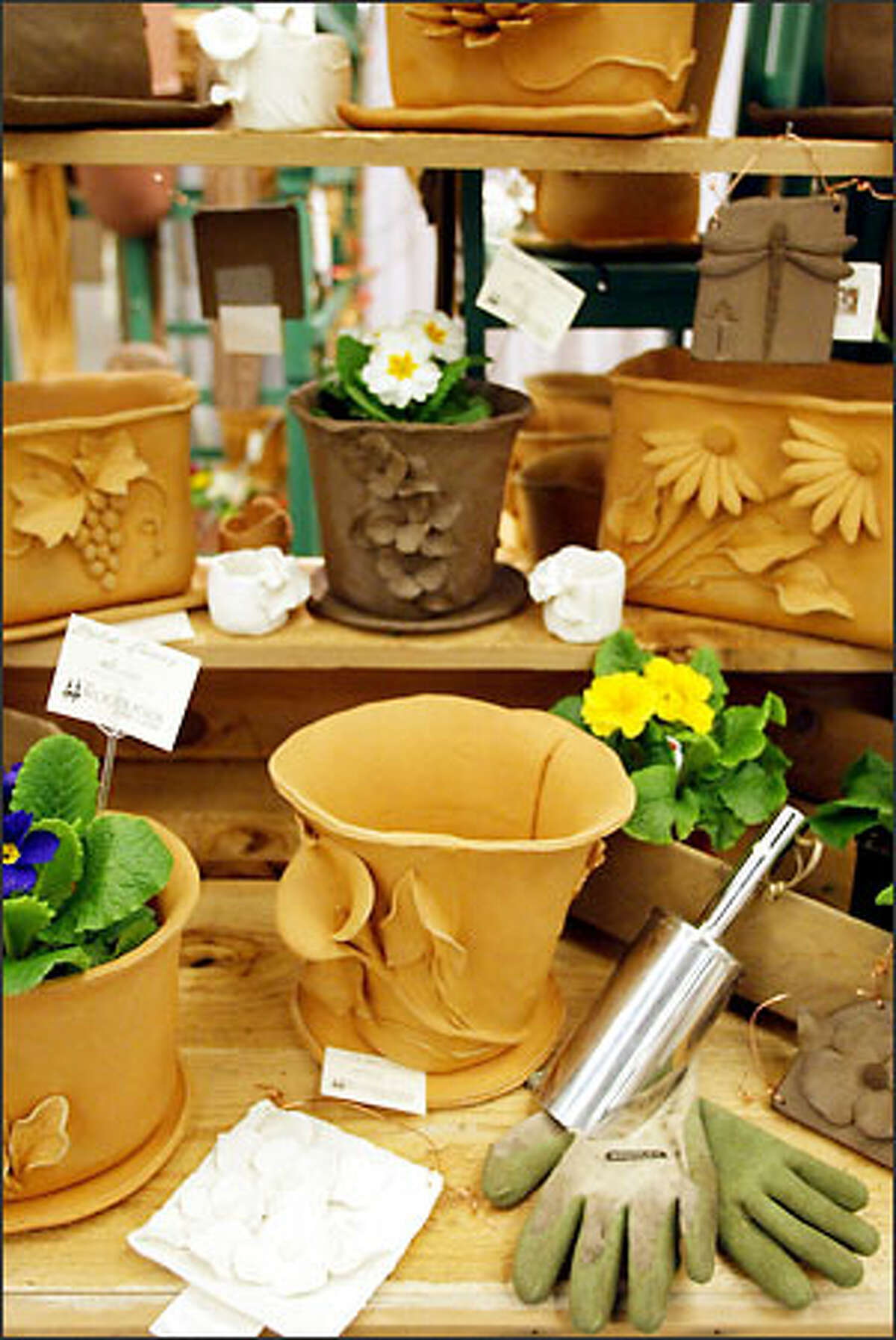 The high-fired stoneware pots in the Woodlands Garden Pottery Booth would be at home indoors or out.