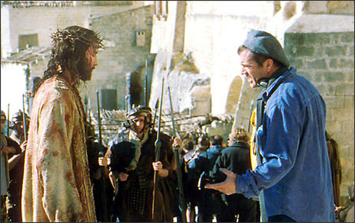 Mel Gibson, right, directs Jim Caviezel on the set of the film, which opens Wednesday. (Philippe Antonello / Marquis Films Ltd.)