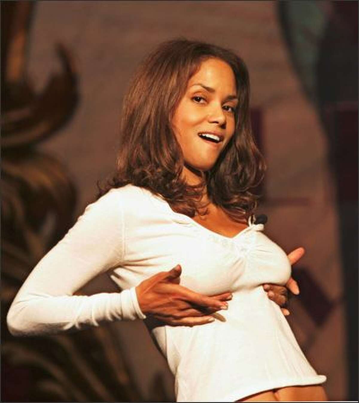 Halle Berry demonstrates the purpose of a brassiere for befuddled Harvard folks during last week's festivities honoring the Hasty Pudding woman of the year. The game Halle was roasted for her pretty, awful portrayal in