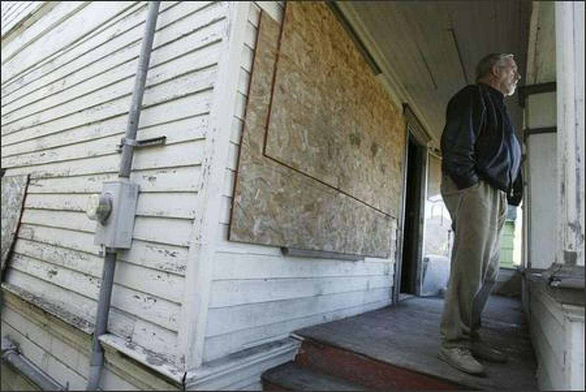 Real estate agent Al Johnson has an open house for brokers at this house at 4425 Cascadia Ave. S. in Seattle. With home prices rising, many people are looking at houses that need work. These days, it makes more sense to buy houses to tear down and replace rather than investing in fixers, a contractor said.