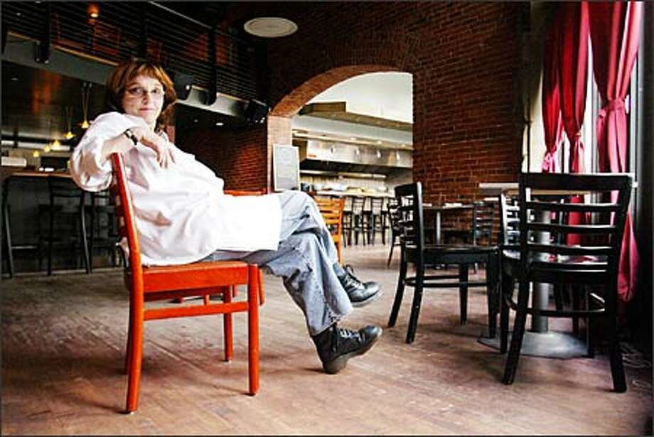 Lois Pierris, chef-owner of Lulu's, takes a moment to relax in her large, open dining space. Photo: Mike Urban, Seattle Post-Intelligencer / Seattle Post-Intelligencer