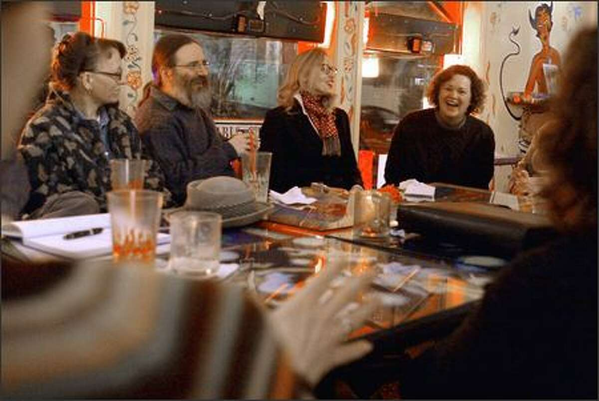 Queen Anne Socrates cafe members, from left, Christine Sannella, Michael Sannella, Jeannette Allée and Margo Pierce, engage in a philosophical discussion at El Diablo Coffee Co. Members gather there weekly for sessions that strive for intellectual honesty through critical questioning, a la Socrates, the fifth-century B.C. Greek philosopher.