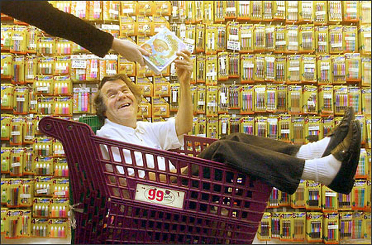 Dave Gold poses in a shopping cart at one of his stores on Christmas Eve in Commerce, Calif. Gold is the founder of the 99 Cents Only Stores chain and the