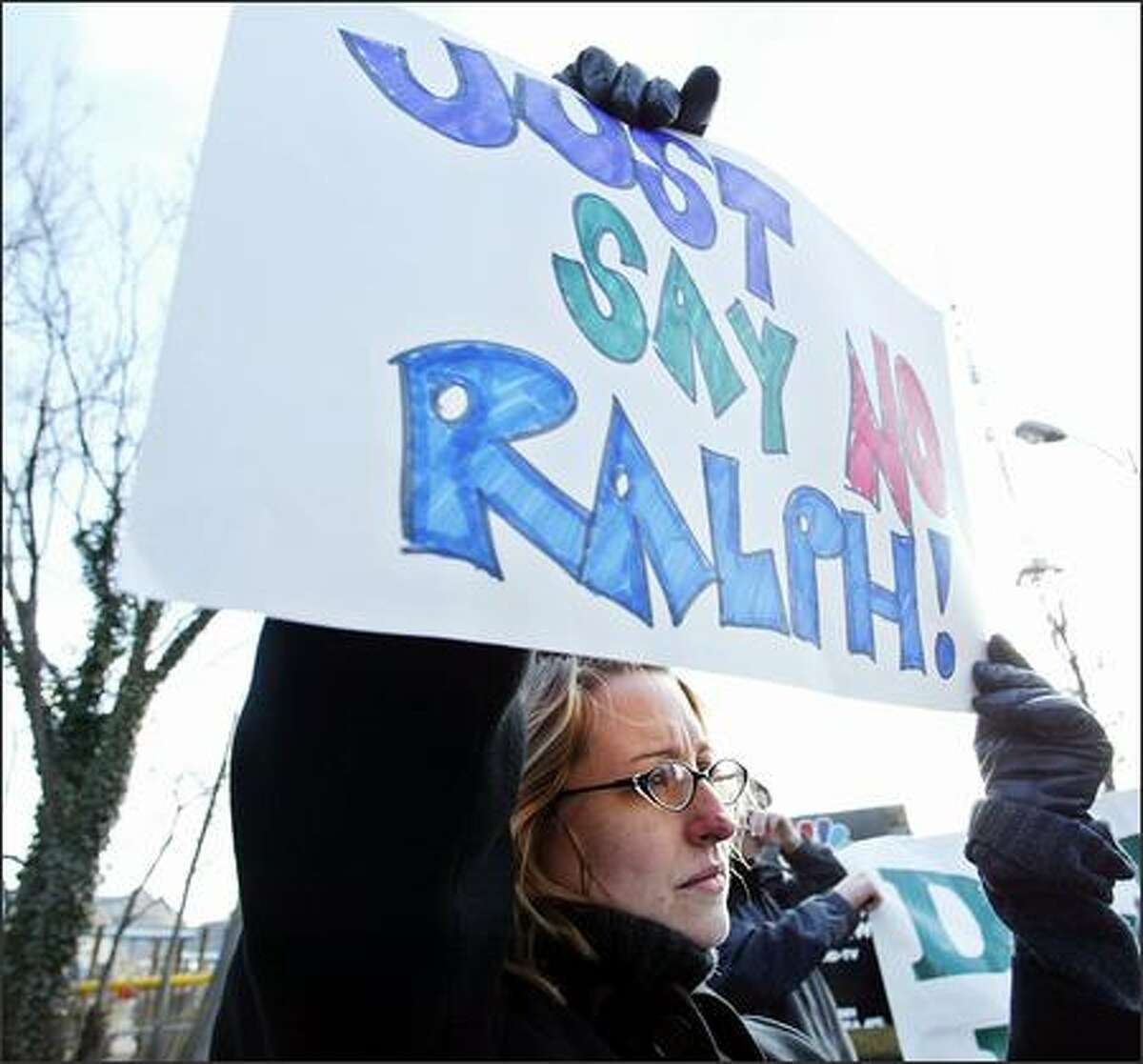 Protestors against Ralph Nader running for the presidency and Nader supporters stage a rally outside the NBC televison station in Bethesda, Md., Sunday. Consumer advocate Nader announced Sunday he will run again for the presidency, declaring that Washington has become
