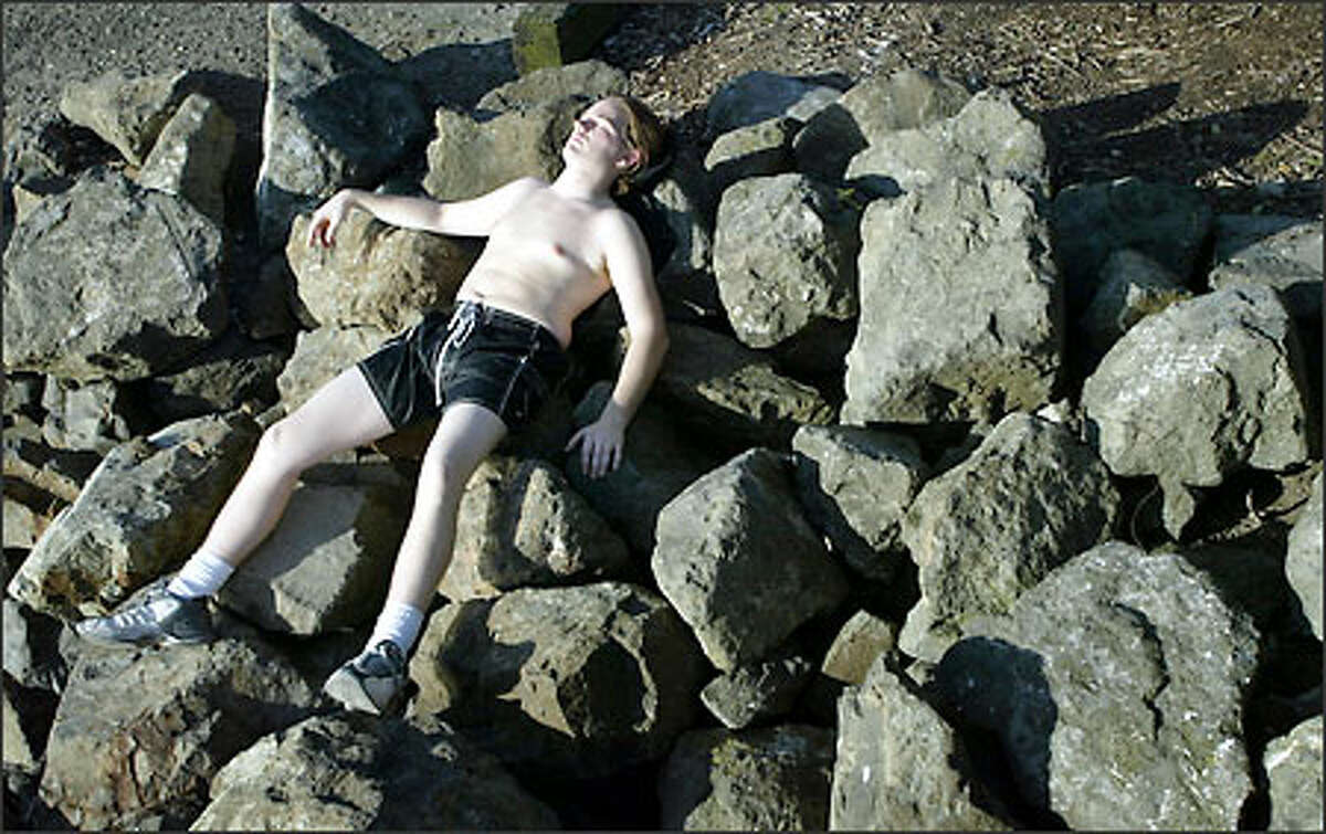With temperatures climbing into the lower 60s Sunday in Seattle, Colin Yokum found the perfect combination of rocks for a siesta at Myrtle Edwards Park. He said his bed of boulders was more comfortable than it looked.