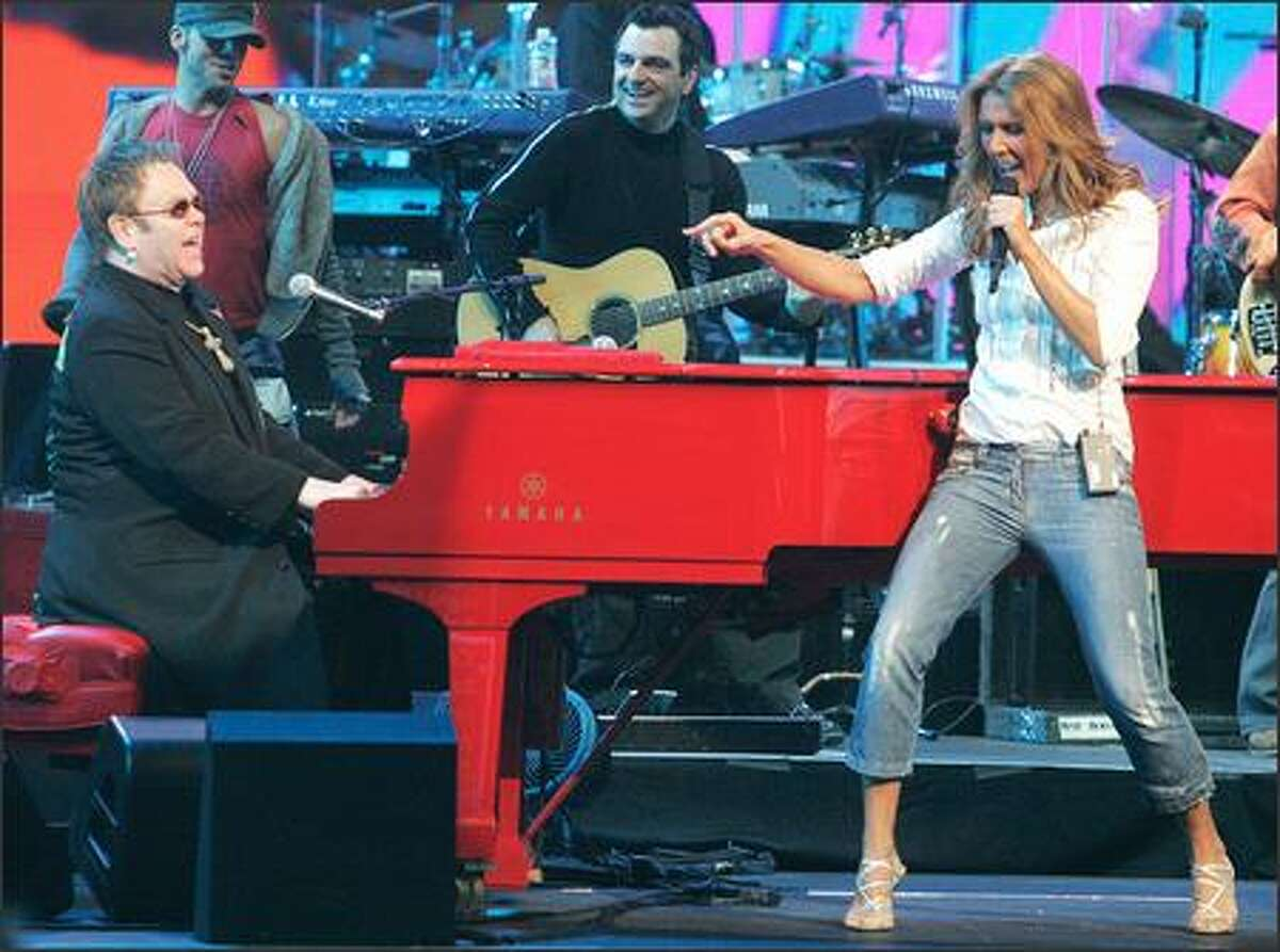 Elton John and Celine Dion prove two divas can share the stage and still survive. The two performed together for the first time at Las Vegas' Caesars Palace in a benefit performance Monday night that raised $2.1 million for casino employees affected by Hurricane Katrina.
