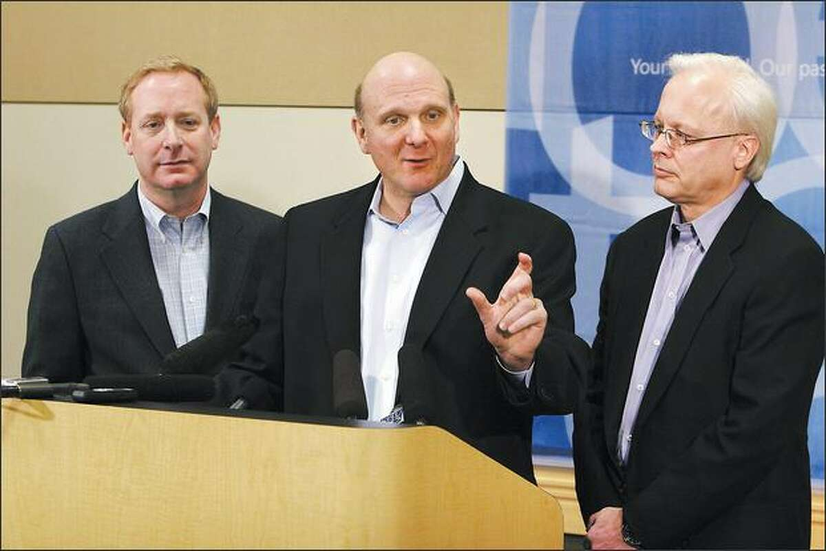Microsoft Chief Executive Officer Steve Ballmer, center, General Counsel Brad Smith, left, and Chief software architect Ray Ozzie, answer questions during a press conference on February 21, 2008 at Microsoft's Redmond, Wash. campus, about their announcement to make strategic changes in their practices to expand interoperability.