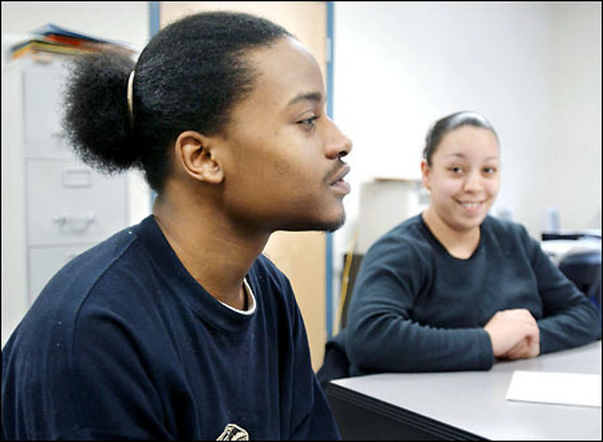 Laid-off dot-commers and the hyper-educated get the headlines, but Bryant Jones of Boston, left, and Priscilla Ramirez of Brookline, Mass., more truly depict the jobless picture.