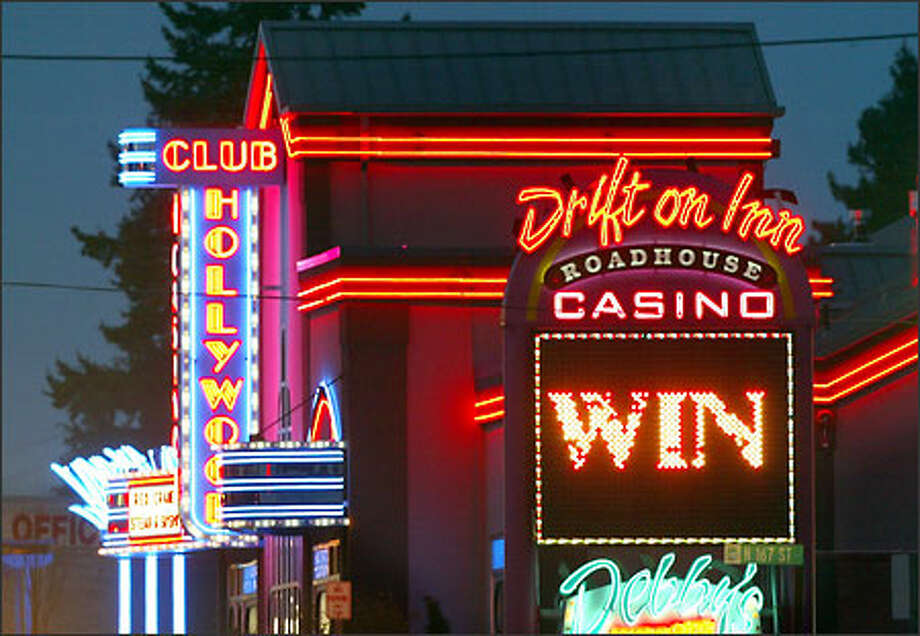 The bright lights of two card rooms on Aurora Avenue North in Shoreline owned by the same family attract gamblers 24 hours a day. Photo: Joshua Trujillo, Seattlepi.com / seattlepi.com
