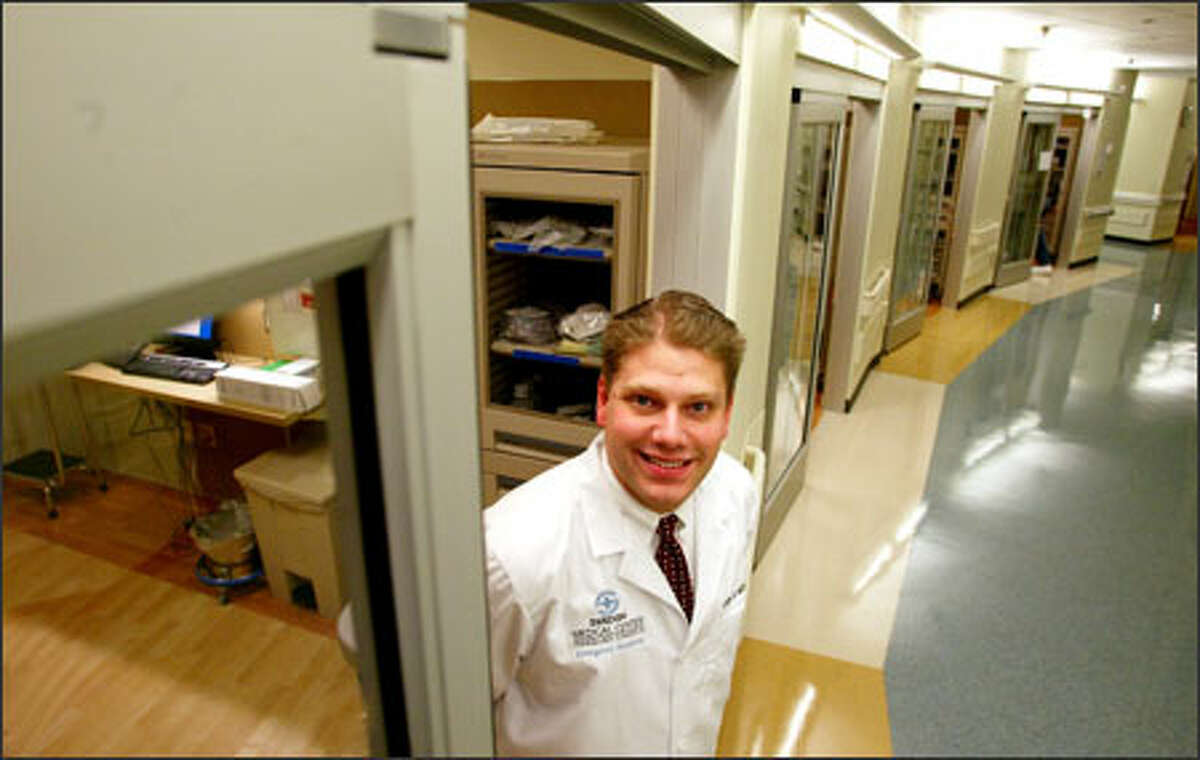 Dr. John Milne shows off the Swedish Medical Center's emergency room, which opens Tuesday in Issaquah, near Overlake's new urgent care facility.