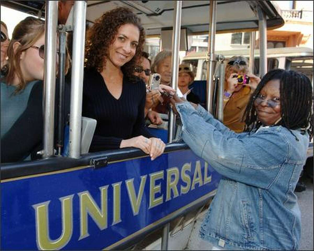Whoopi, Whoopi, Whoopi. Your career is in danger, girl, if you're down to posing with tourists at Universal Studios and narrating about