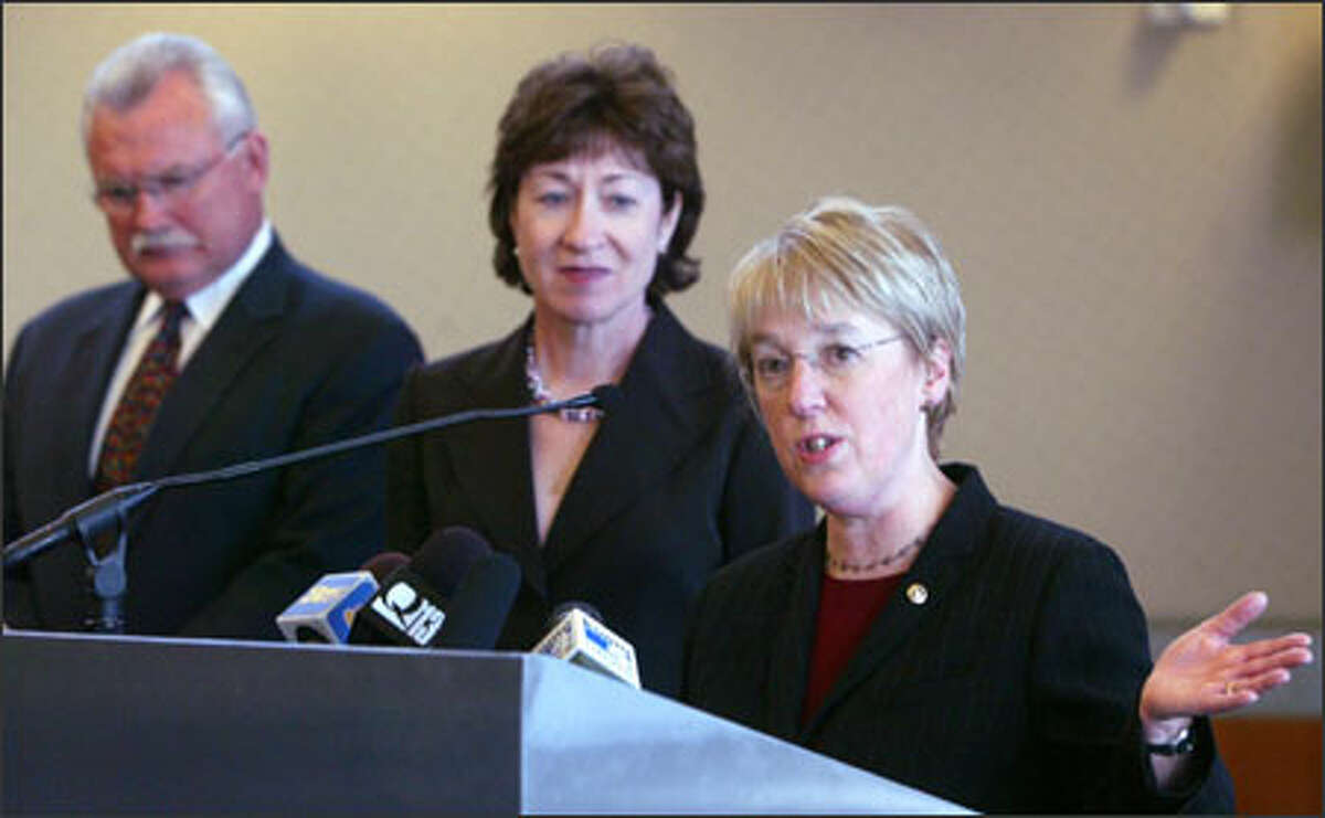 From left, Port of Seattle Chief Executive Mic Dinsmore and Sens. Susan Collins, R-Maine, and Patty Murray, D-Wash., discuss the sale of port operations at a news conference in Seattle Wednesday.