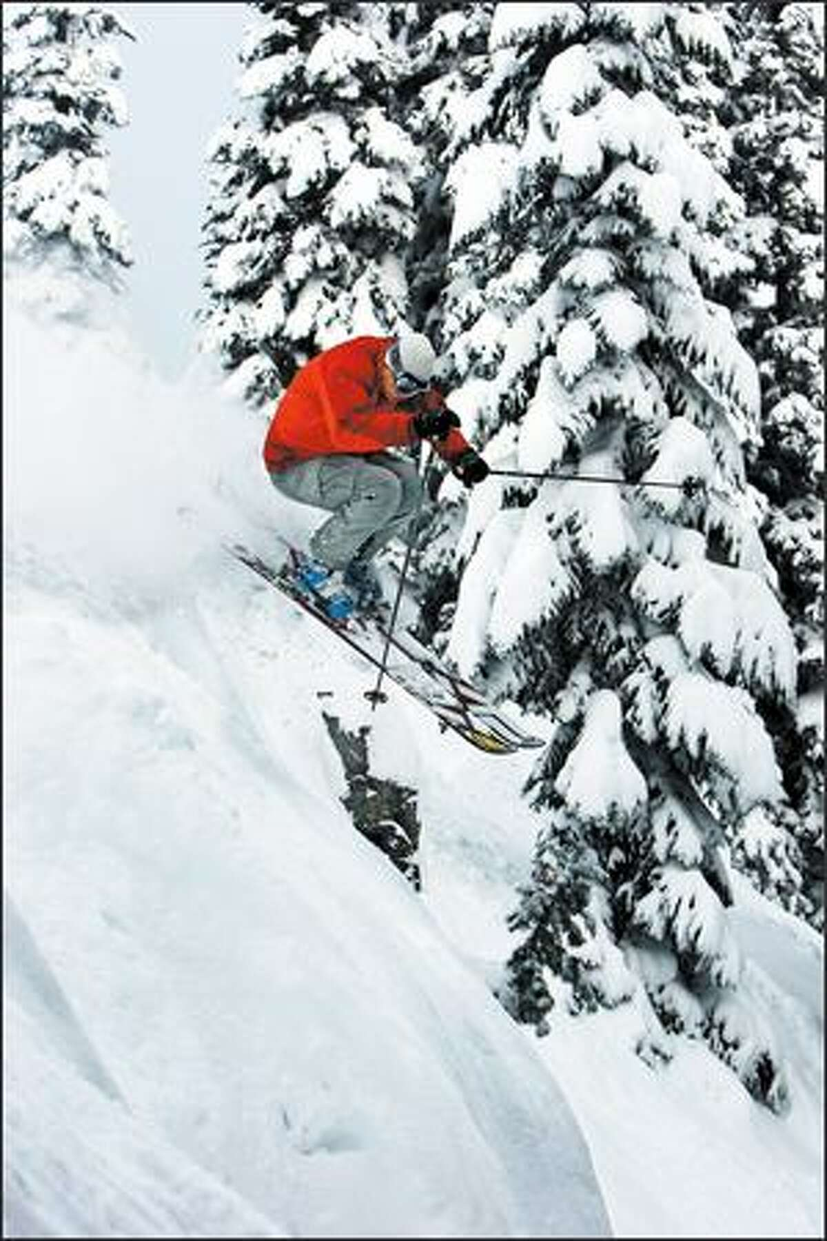 Keith Rollins, who makes his living as a freeskier, pops through fresh powder in Crystal Mountain's backcountry.