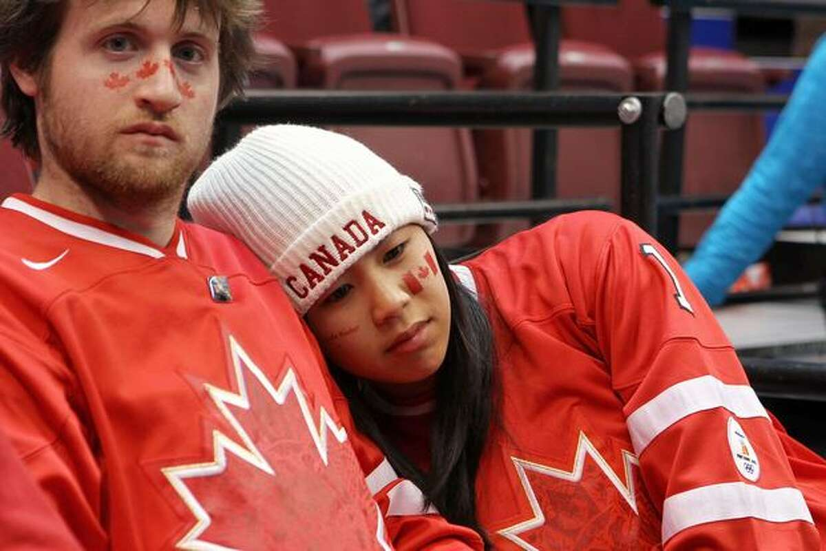 Canadian fans react after Canada lost a men's ice hockey preliminary game against the USA last Sunday in Vancouver.