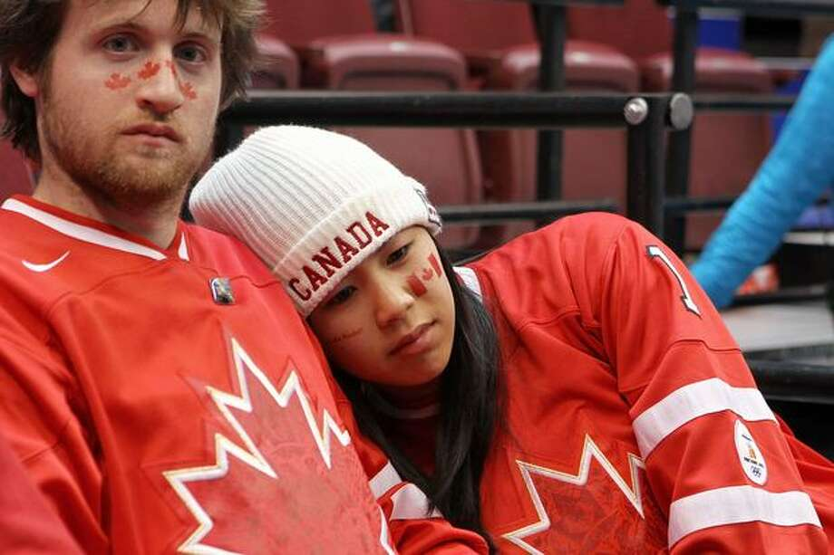 Canadian fans react after Canada lost a men's ice hockey preliminary game against the USA last Sunday in Vancouver. Photo: Getty Images / Getty Images