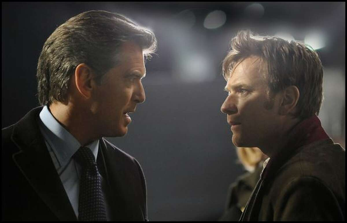 Pierce Brosnan, left, and Ewan McGregor are shown during the filming of