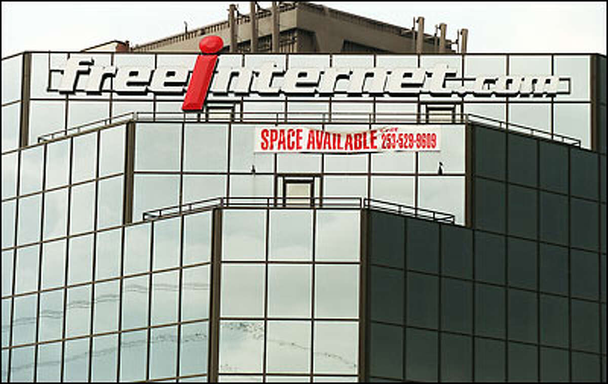 The Freeinternet.com logo still adorns a building in Federal Way even though the company went bankrupt and moved out last year.