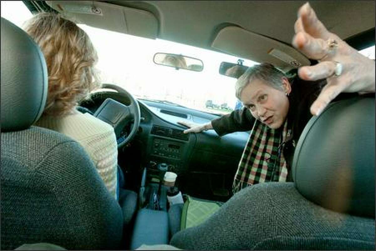 Driving instructor Toni Ciardullo talks to students in the back seat before they leave the parking lot at North Seattle Alliance Church. Alicia Caulfield is the driver.