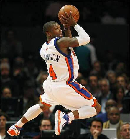 Nate Robinson, Rainier Beach, 2002: Robinson was a standout in basketball, track and football at Rainier Beach High School. He also was a star football and basketball player at the University of Washington, where his dad was a standout football player. A three-time NBA slam dunk contest champion, Robinson now plays with the Chicago Bulls, his fifth NBA team. His No. 2 jersey was retired in 2010 at Rainier Beach, where he helped the Vikings with a Class 3A state championship as a senior. (AP) Photo: Associated Press / Associated Press