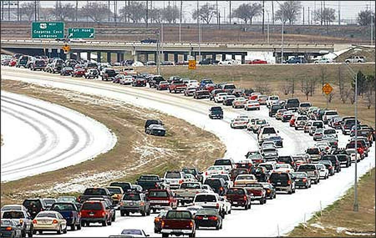Traffic backs up near the main gate at Fort Hood on U.S. Highway 190 in Killeen, Texas, Tuesday, Feb. 25, 2003. Over an inch of freezing rain, sleet, and snow fell on Central Texas Monday night and Tuesday morning. (AP Photo/Killeen Daily Herald, Steve Traynor)