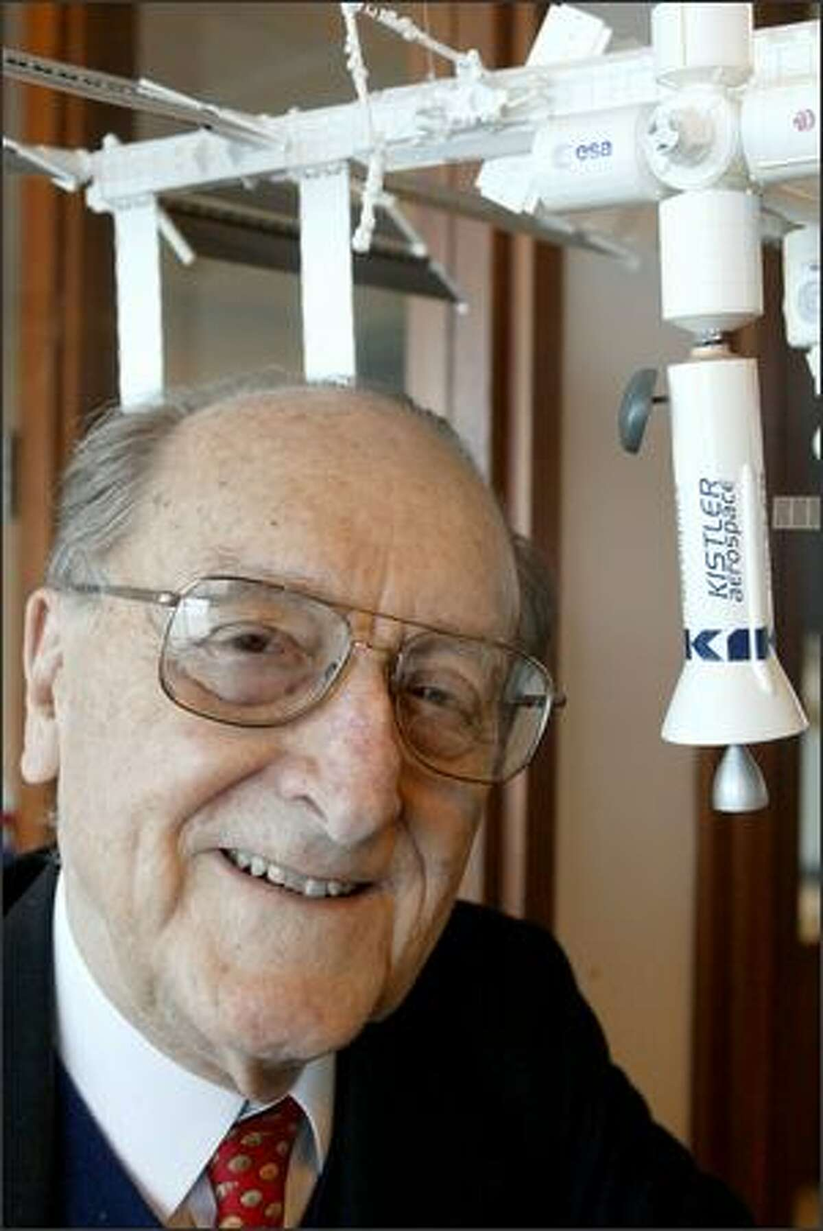 George Mueller and a model of the space station, with one of his company's K-1 rockets attached.