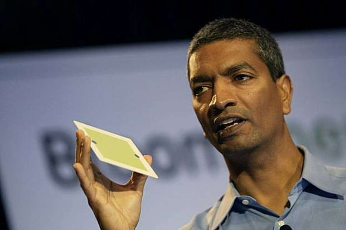K.R. Sridhar, co-founder and chief executive officer of Silicon Valley startup Bloom Energy, holds up a fuel cell.