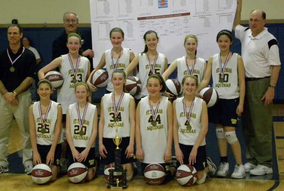 The St. Thomas Aquinas varsity girls basketball team won the New England championship on Sunday in Manchester, N.H. Pictured above, front row from left, Caroline Ketcher, Kara Duggan, Tori Stapleton, Olivia DeFeo and Maggie Salandra; back row: head coach Mike Hooper, coach Brian Sacco, Jackie Brewster, Patricia Auray, Samantha Dunn, Sophie Benedetti, Haley Congdon and coach Jim Brewster. Photo: Contributed Photo / Fairfield Citizen contributed
