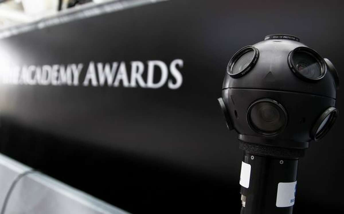 A 360-degree camera is seen on the red carpet for the 83rd Academy Awards outside the Kodak Theatre in Los Angeles on Friday. Fans will be able to control a handful of such cameras placed around the Academy Awards on Sunday. (AP Photo/Matt Sayles)