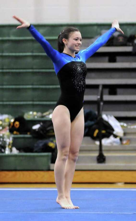 Sophie Tomeo performs for Fairfield Ludlowe on the floor at New Milford High School during the CIAC Class M Gymnastic Championships on Saturday Feb. 26, 2011. Photo: Lisa Weir, ST / The News-Times Freelance