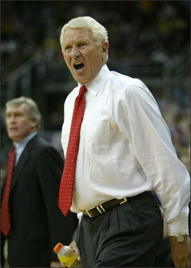Arizona head coach Lute Olson lets his emotion be known as his team falls behind on Saturday. Photo: Joshua Trujillo, Seattlepi.com / seattlepi.com
