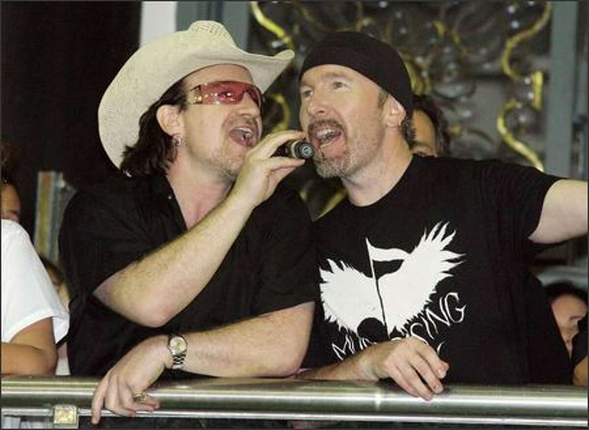 Bono and the Edge perform during Carnival in Salvador, Brazil. What do you think the chances are that they're doing a cover of Kevin Federline's