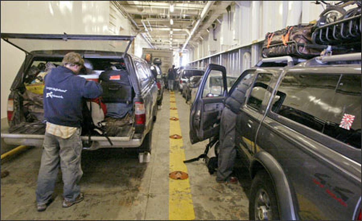 Passengers unload belongings from their cars on the Alaska Marine Highways ferry M/V Columbia before departing Bellingham for Alaska. The first leg to Ketchikan takes 38 hours; the entire trip takes three days.