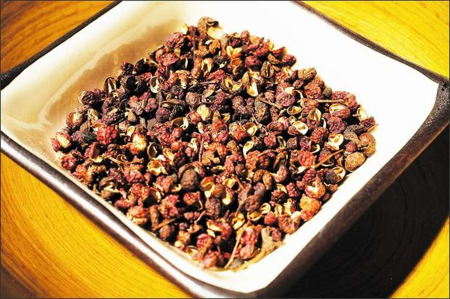 The Szechuan peppercorn is an essential ingredient in Szechuan cooking. Its numbing spiciness is surprising for those new to the cuisine. Photo: Meryl Schenker, Seattle Post-Intelligencer / Seattle Post-Intelligencer