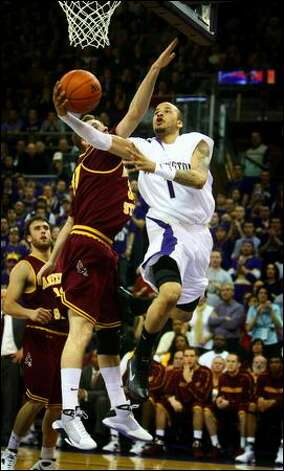 Huskies guard Venoy Overton goes to the hoop as Arizona State's Rihards Kuksiks defends. Photo: Joshua Trujillo, Seattlepi.com / seattlepi.com