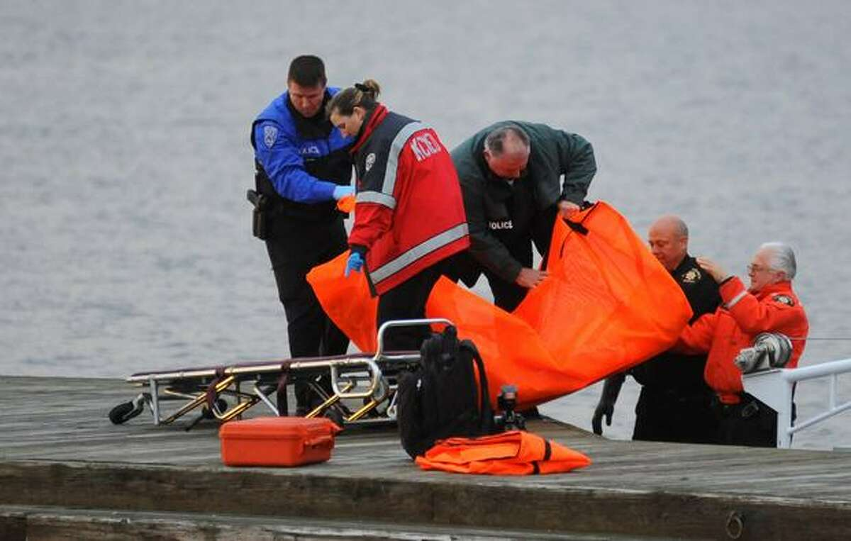 The body of a man who was discovered floating 15 yards offshore in Lake Washington is lifted out of the King County Sheriff marine boat at Marsh Park in Kirkland Saturday evening Feb. 27, 2010.