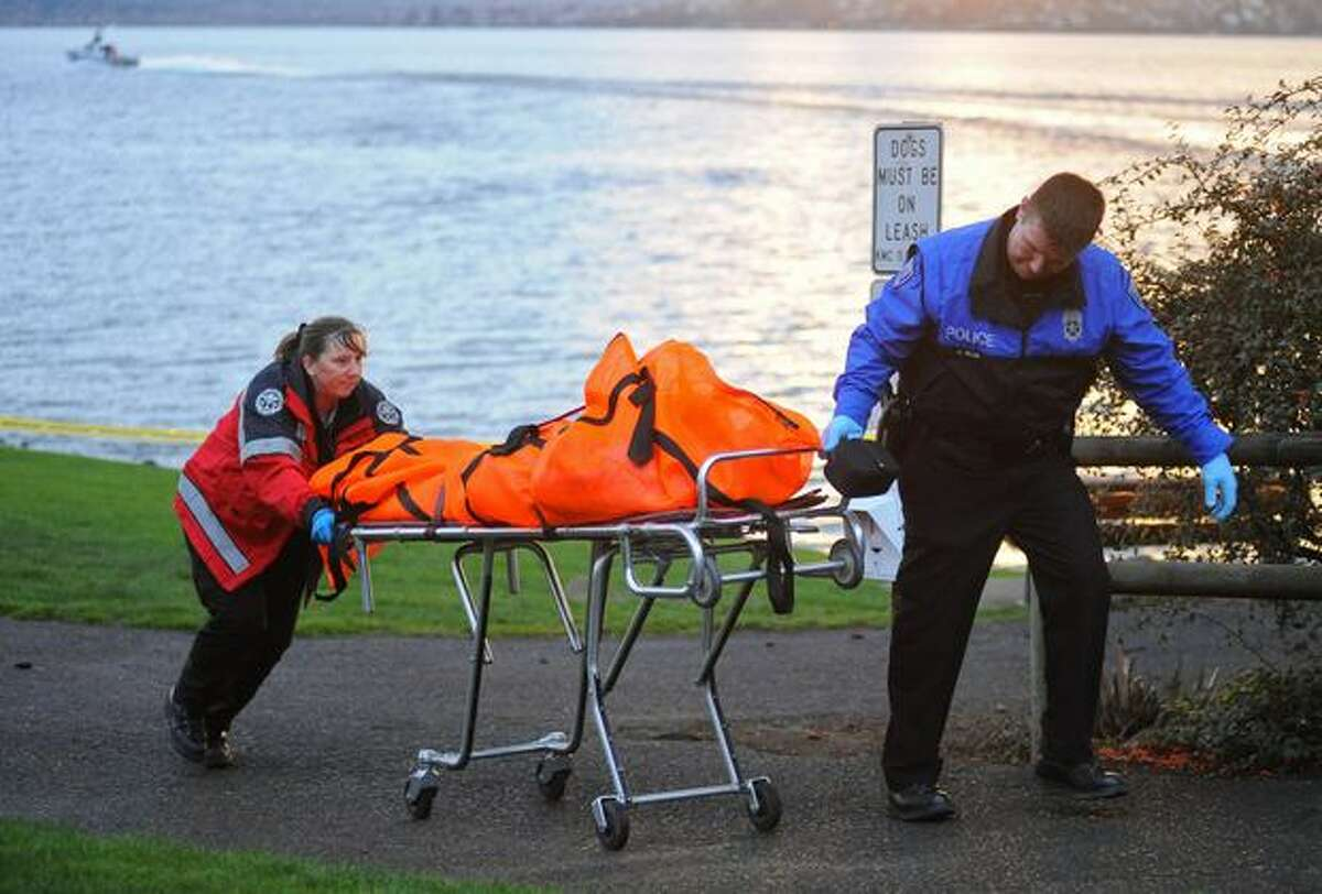 The body of a man who was discovered in Lake Washington floating 15 yards offshore from Marsh Park in Kirkland is taken away from the dock Saturday evening Feb. 27, 2010.