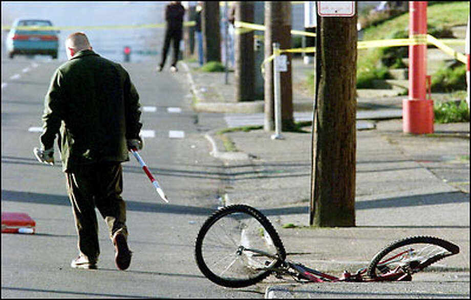 The bicycle being ridden by Joel Robert Silvesan was knocked about 50 yards, landing across Aurora, after being hit by Patrolman Chris Hansen's car. Photo: Dan DeLong, Seattle Post-Intelligencer / Seattle Post-Intelligencer